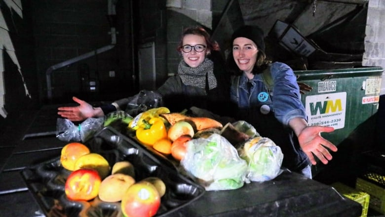 These students are serving dumpster food at the dinner table