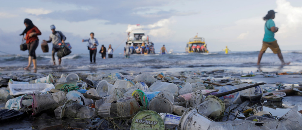 This man is installing 100 trash barriers in Bali's rivers to stop plastic pollution.
