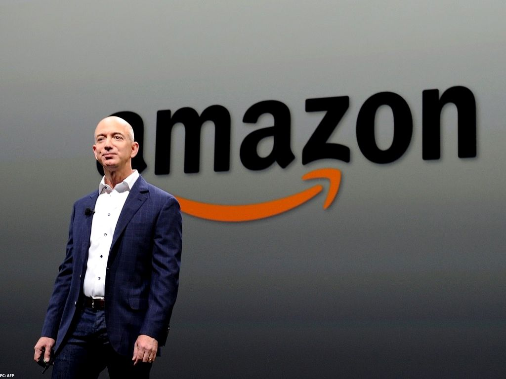 Amazon signs big allies in pledge to be carbon neutral
